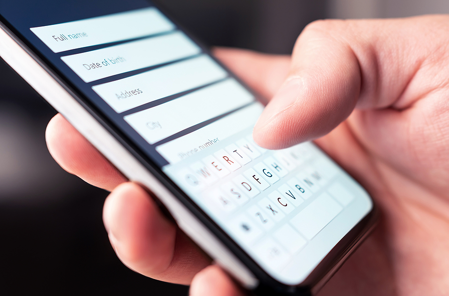 Person filling out contact form on phone